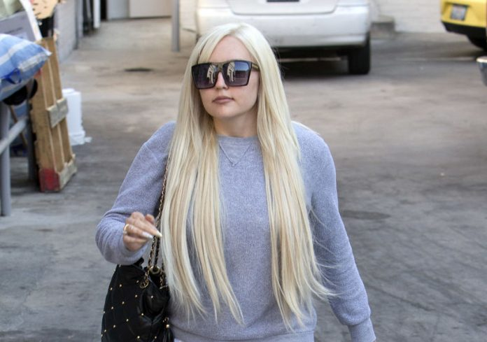 Amanda Bynes with extra long pointed nails and long Blonde hair was seen leaving 'The Glam Salon' in Beverly hills CA