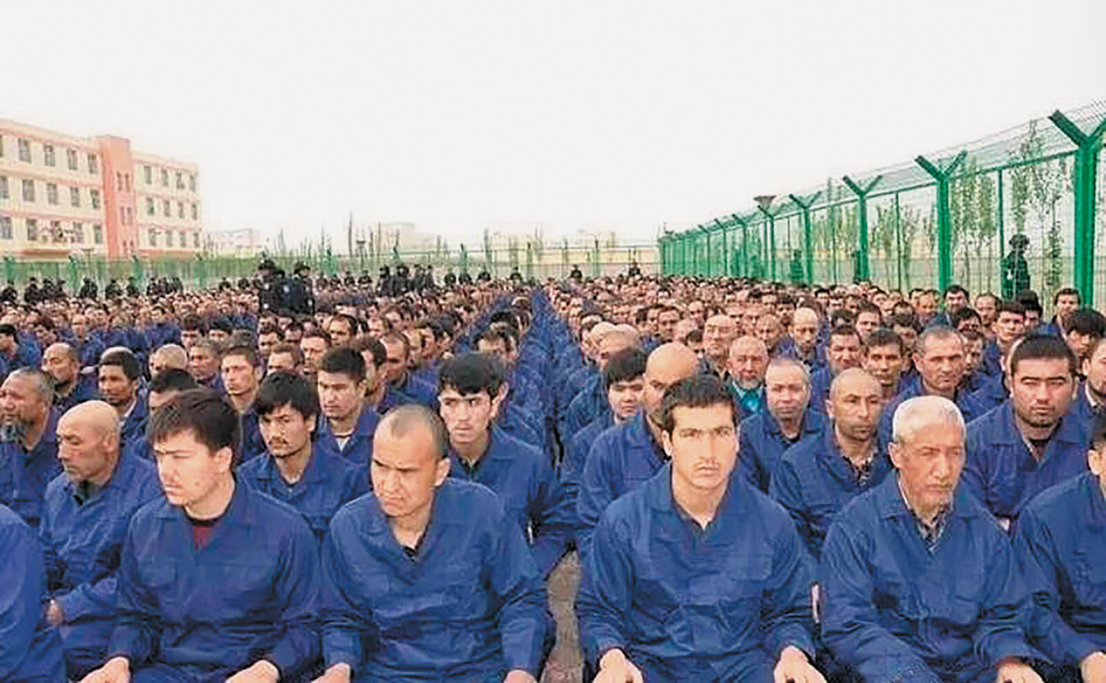 "Uighur detainees listening to a ""deradicalization"" presentation at a reeducation camp, in a photo posted to the Xinjiang Judicial Administration's WeChat account, Hotan Prefecture, Xinjiang, 2017"